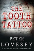 *The Tooth Tattoo* by Peter Lovesey